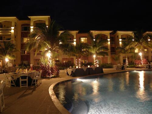 banquet tables by the pool at nighttime