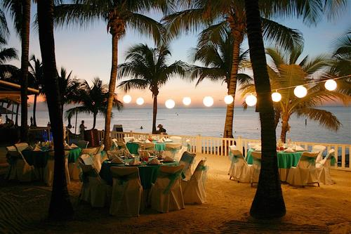 banquet tables on beach at sunset