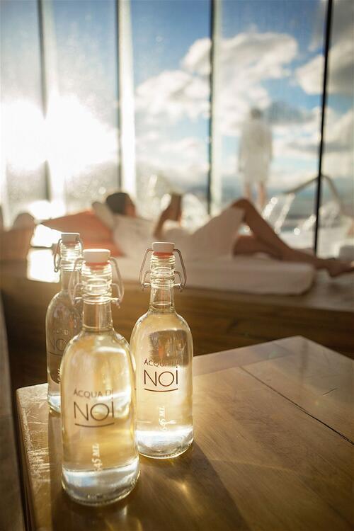 3 glass water bottles kept on table in Aiken Spa at NOI Indigo