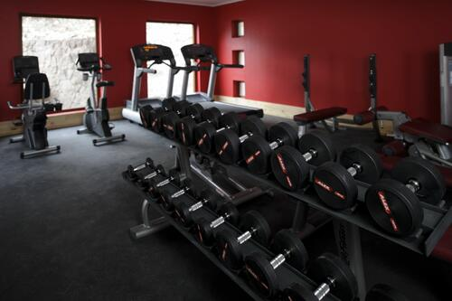indoor equipped Gym for fitness at NOI Puma Lodge Hotel