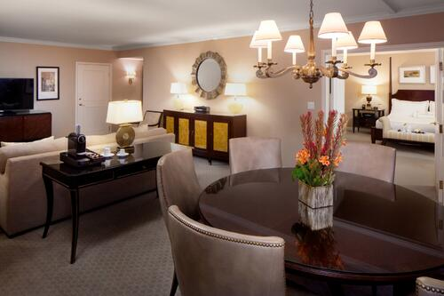 Table and couch in presidential suite living area
