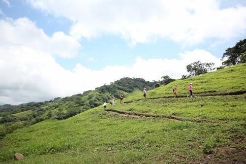 group hiking on mountain