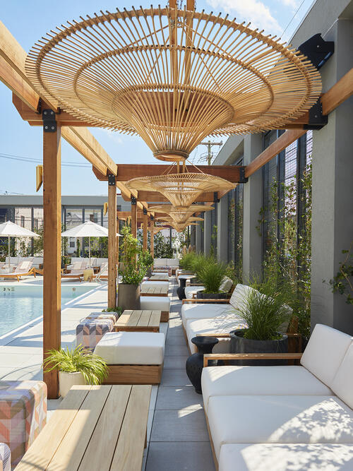 Pool Cabanas with seating area at the Rockaway Hotel