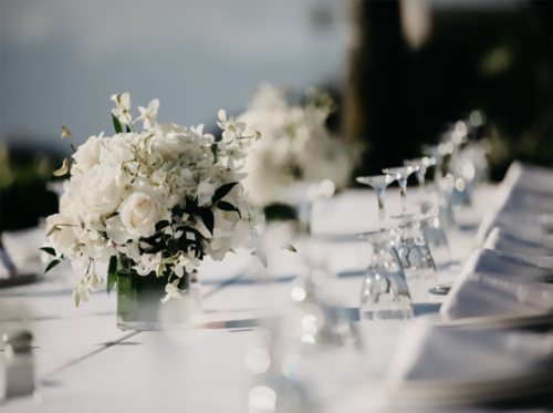 wedding table with glasses and flowers