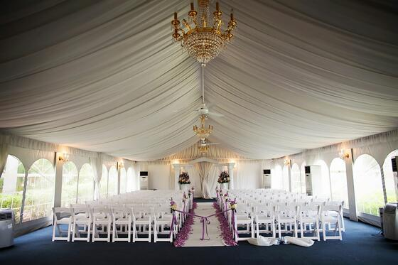 Wedding under canvas tent with chandelier.