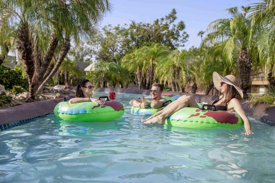 Adults floating in lazy river