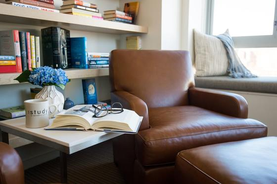 Leather chair and book on side table