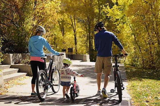 Family walking bikes in Glenwood Canyon in Fall