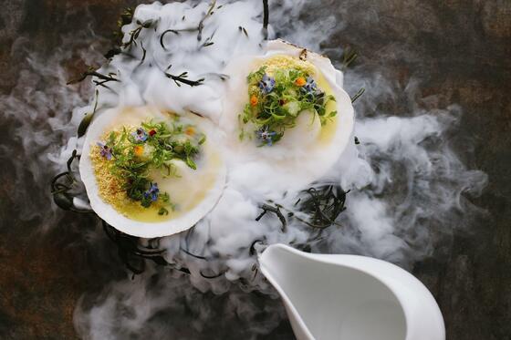Scallops served under a delicate mist