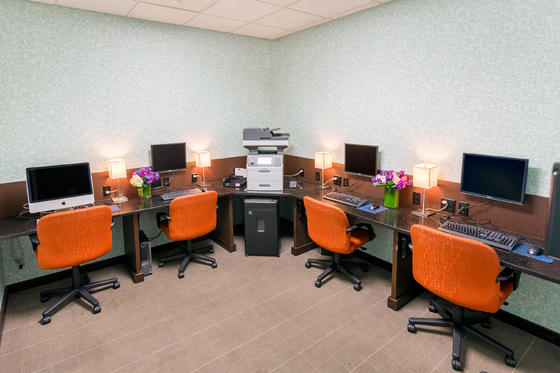 business center with chairs and computers