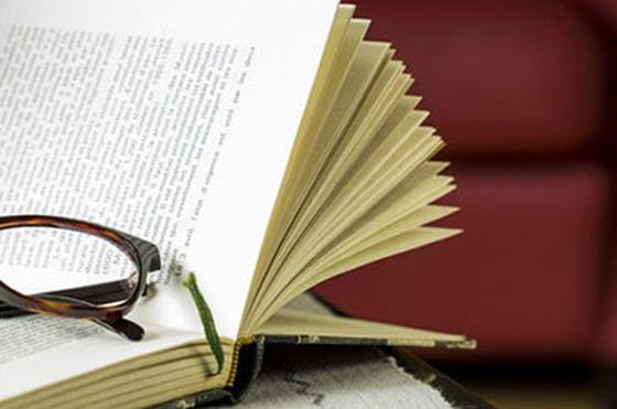 Close photo of a book with glasses