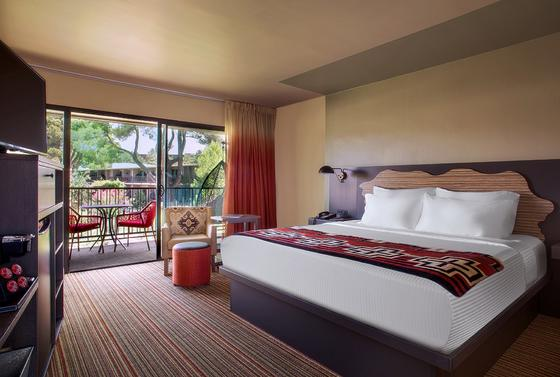 Courtyard suite hotel room, king bed and view of Red Rocks.