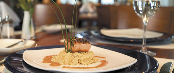 cooked salmon on a bed of rice