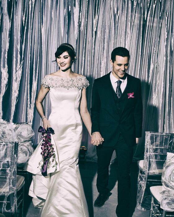 Bride and groom walking down aisle.