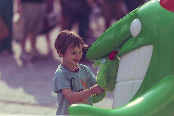 Child talking to theme park character.