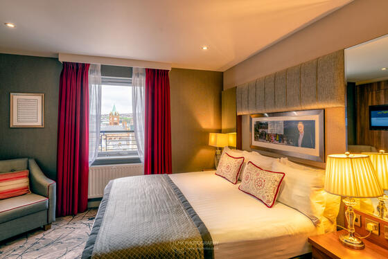 City Hotel Derry Coulter Suite Bedroom With View Of Guildhall