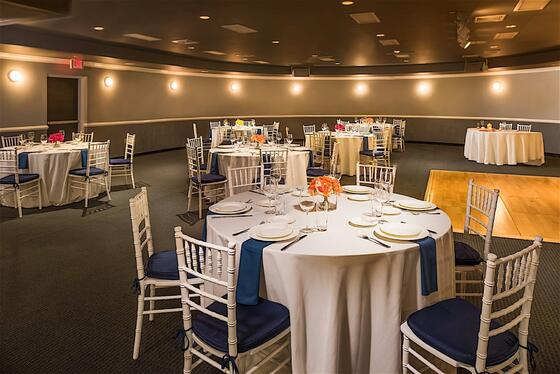 banquet room with tables set for dinner