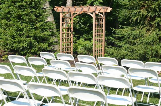 chairs lined up in front of outdoor gazebo