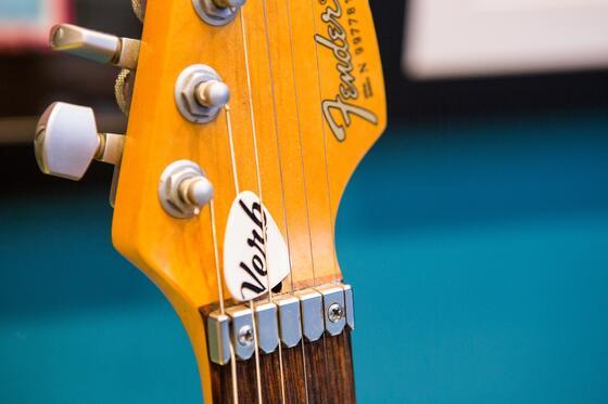 Fender guitar neck detail shot with Verb branded pick