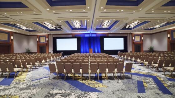 large conference room with two large projector screens