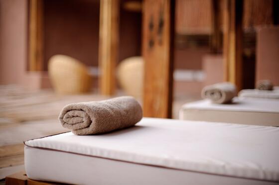 relaxing spa beds and towel rolls at NOI Casa Atacama Hotel