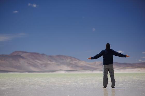 man front of Lagunas Altiplanicas near NOI Casa Atacama Hotel