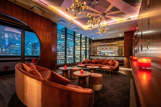 lounge area with city skyline through the windows