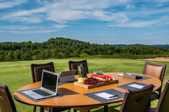 Laptop on outdoor table at golf course
