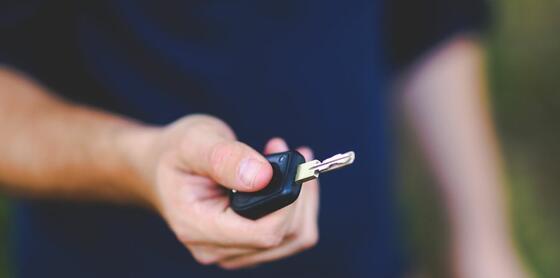 A man holding a key of a car at Vasa Hotel Surabaya