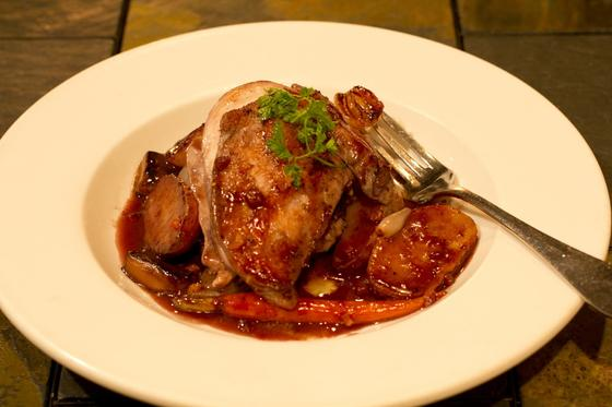 plate of roasted chicken with sauce