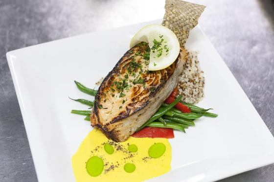 cooked fish with vegetables on a plate