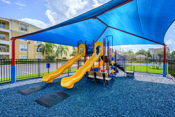 a covered play area with two slides