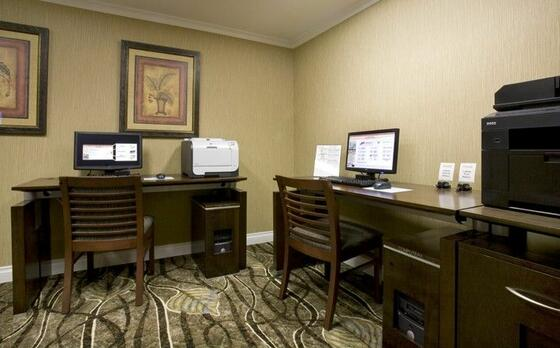 office with desks, computers and printers