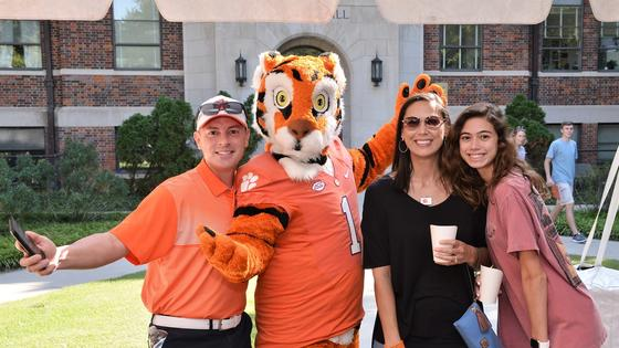 family poses with the clemson tiger mascot