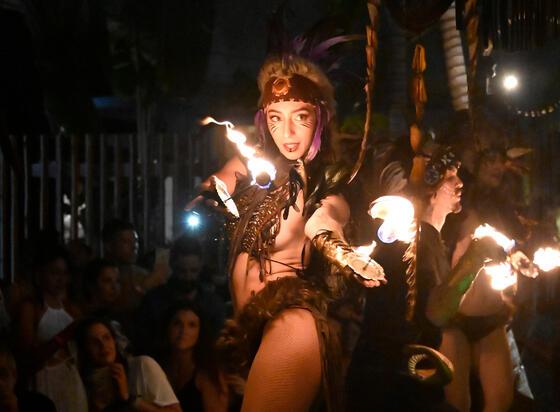 woman in tribal costume fire dancing
