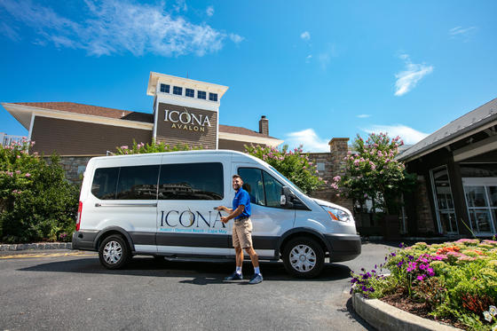 man opening ICONA van door