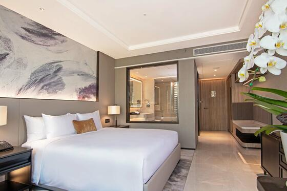 modern hotel room with king bed