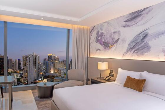 luxury room with king bed and city views