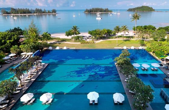 Swimmng pool with sunbeds at The Danna Langkawi