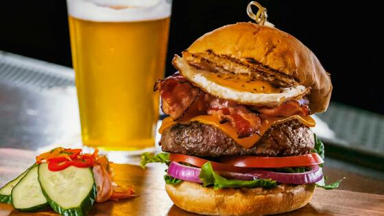 hamburger with a draft beer