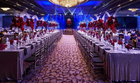 Wedding Set-up with long tables and red flowers