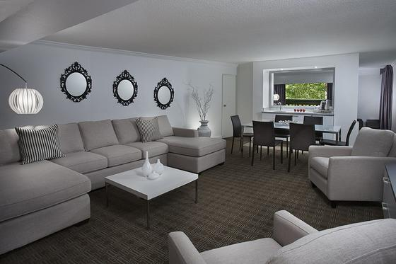 Large couches and chairs in a hotel suite