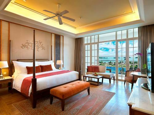 Viceroy room furnished with a king bed, wide windows, tv and mor