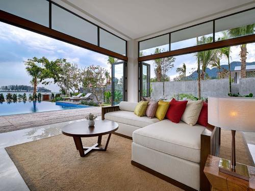 Sofa area facing the pool and sea