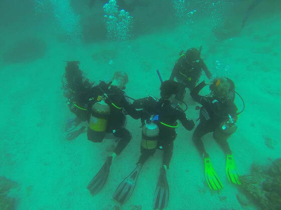 Divers at the ocean bed in Club Mykonos