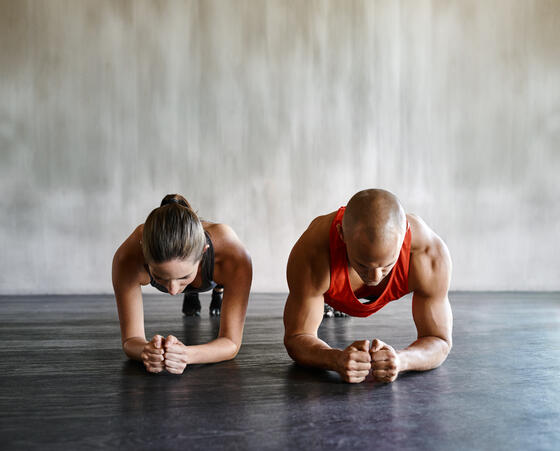 man and woman holding plank position