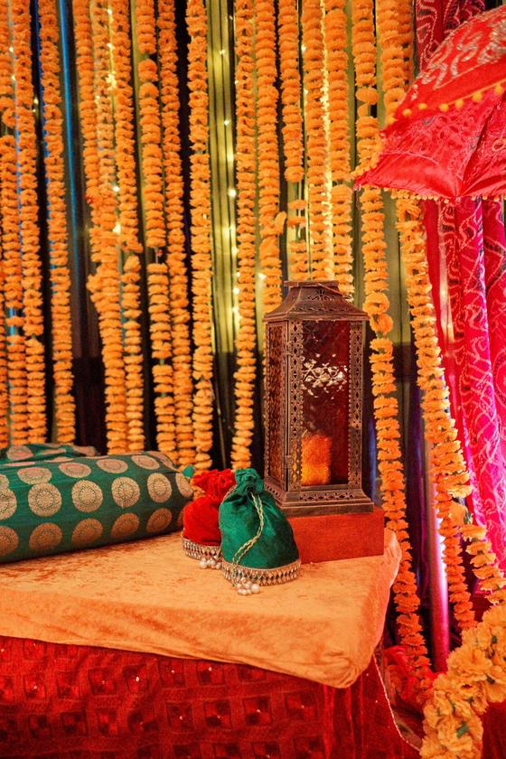 south asian ceremony décor with yellow flowers and colorful deco