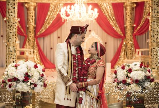 indian wedding couple standing together