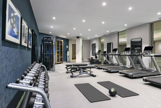 fitness center with exercise equipment, mats and treadmills