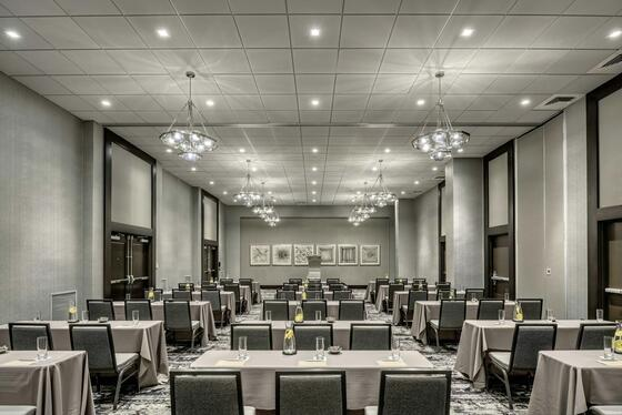banquet room with tables and chairs set for conference